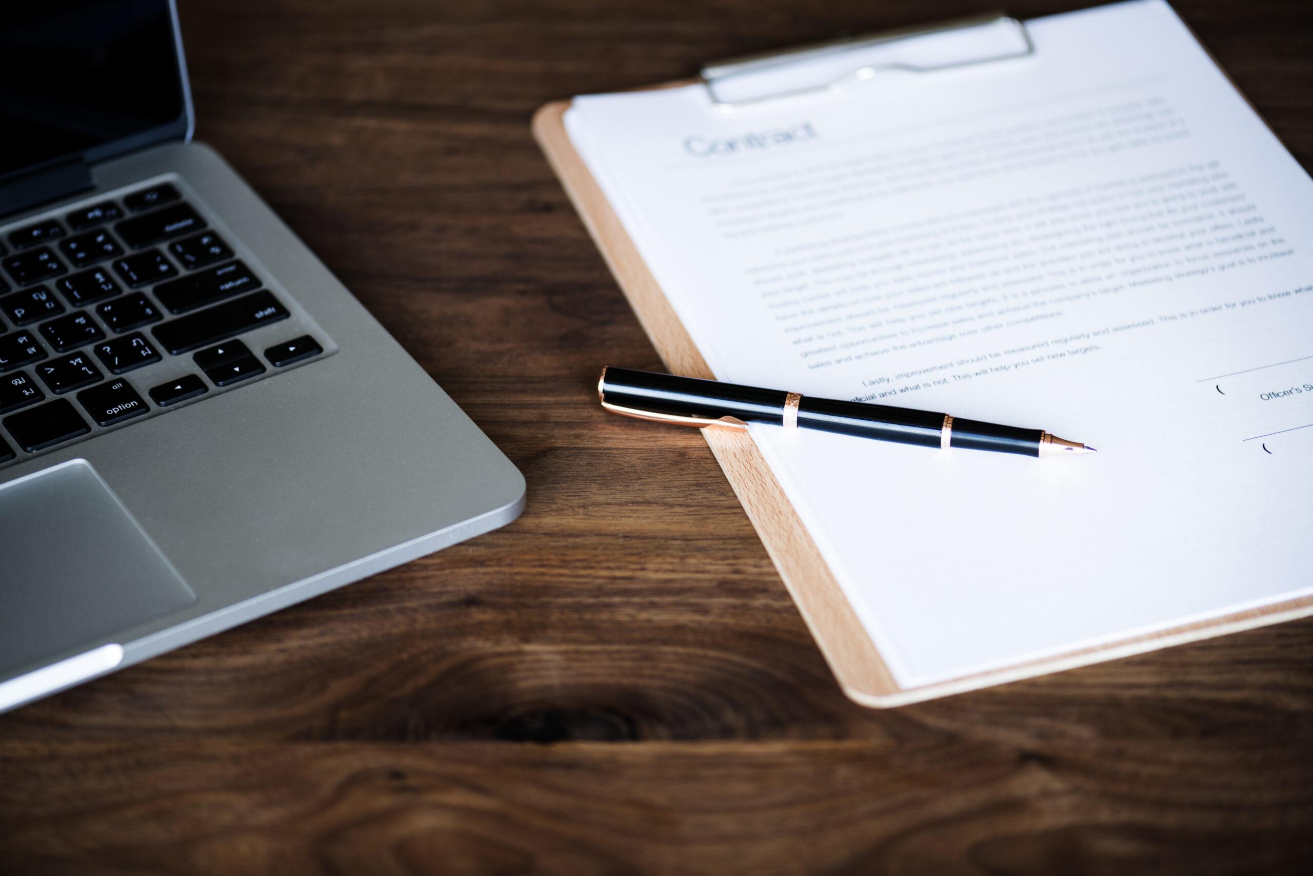 Flat lay laptop application form pen